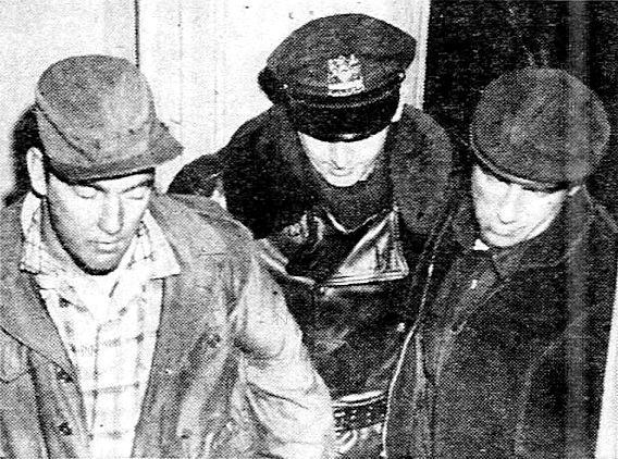 Bandits John (left) and Francis Romano as they are brought into the Amsterdam Avenue station house by Officer Ray Douglas.