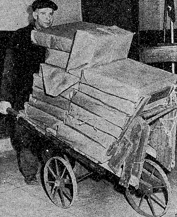George Kuscinkas pushing his cart loaded with art supplies.