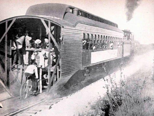 Charlie Murphy Riding Behind Train
