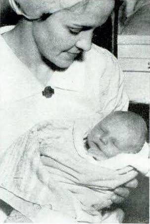 Baby Moses being cared for at the Charity Hospital in New Orleans.