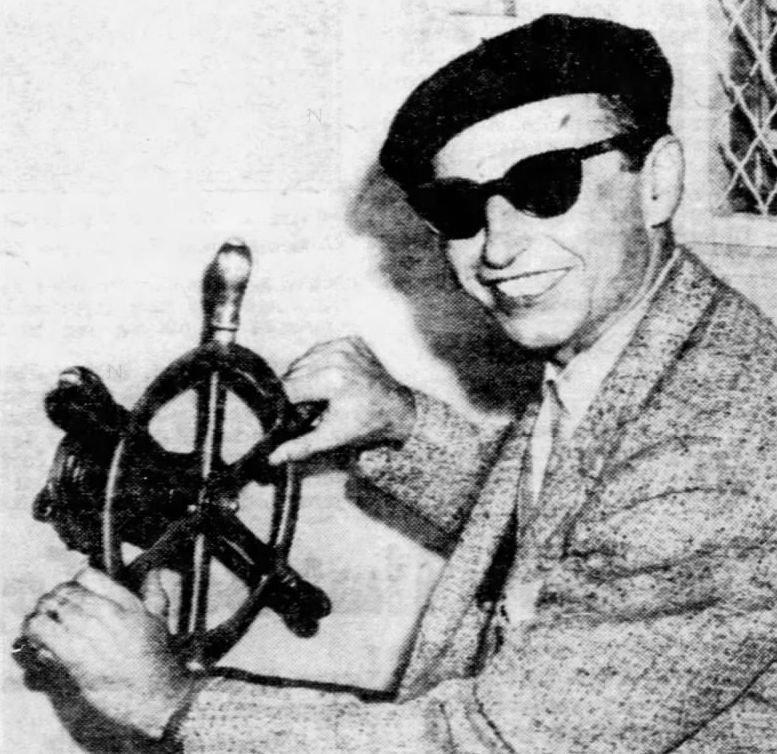 Emanuel K. Bredel posing for the cameras after his arrest.