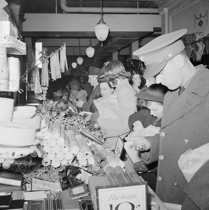 Customers shopping at a Woolworth's store in Washington, DC for Christmas gifts in December, 1941.