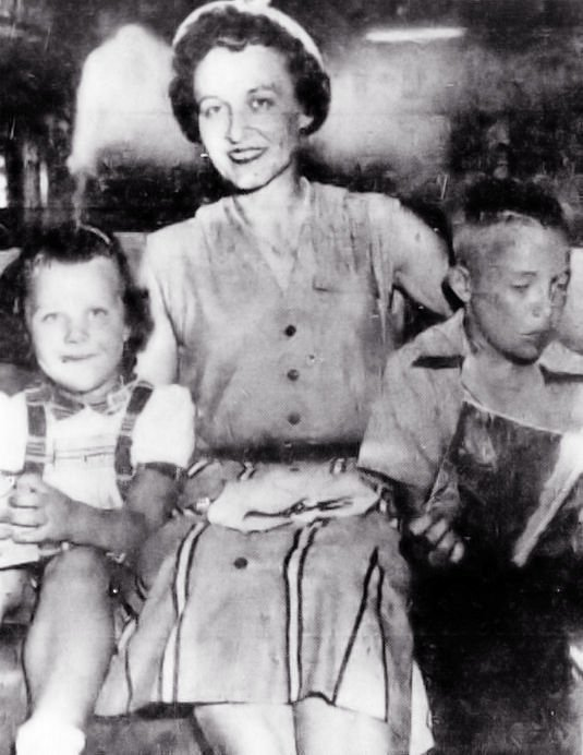 Mrs. Etta R. Crosbie of Elkhart, Indiana with her daughter Karin on the left and son Quin on the right.