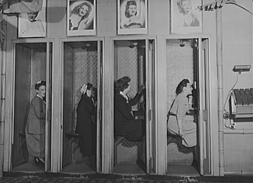 Four women in telephone booths at the Hurricane Ballroom in 1943.