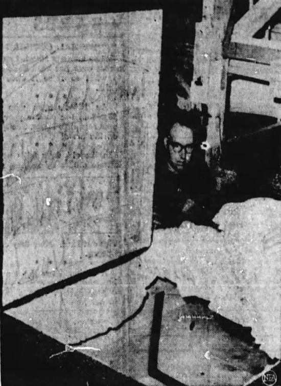 Casketmaker Bill Walker is seen  prepping a large casket to hold the body of Robert Earl Hughes.