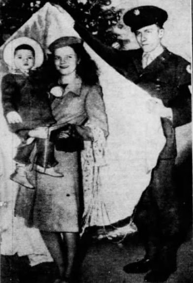 Barbara De Quin and daughter Susan are pictured with the parachute that delivered their Christmas gifts.
