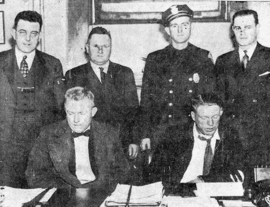 Image of the accused kidnappers. Harry C. Walter is seated on the left, William Chester Marcum to his right.