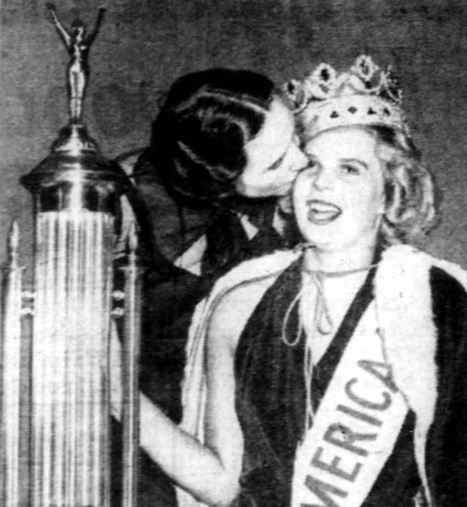 Bette Cooper being kissed by her mother after winning the Miss America 1937 crown.
