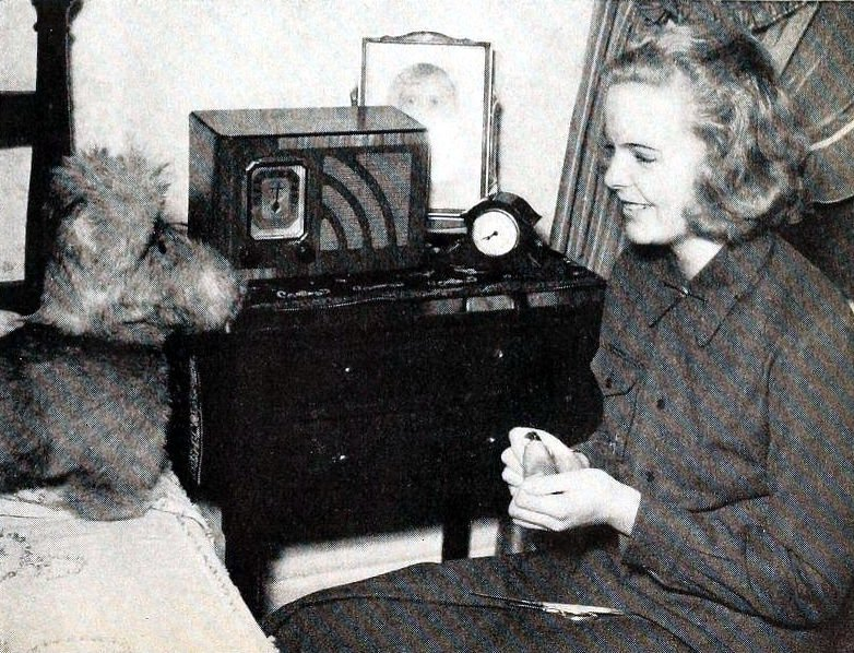 Miss America Bette Cooper at home listening to the radio.