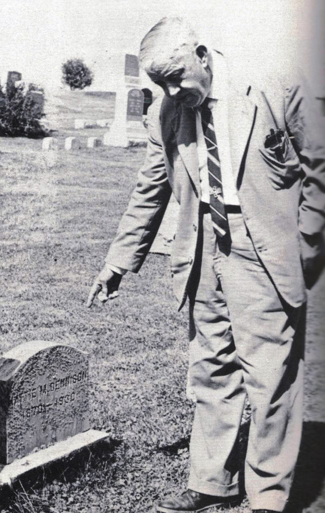 Stephen Dennison visiting his mother's grave.