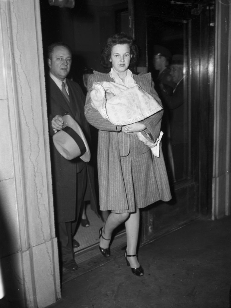 Melba Branson carrying Milly McGill into court.