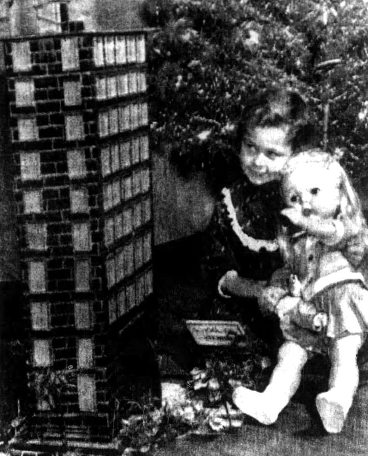 Suzy Dewey with the doll house sent by Cub Scout Pack 3189 of Chicago. Image originally appeared on page 3 of the December 22, 1965 publication of the Pottsville Republican and Herald.