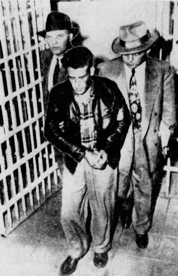 Billy Cook being led into a San Diego jail by two FBI agents. Image appeared on page 1 of the January 16, 1951 issue of the Springfield Leader and Press.