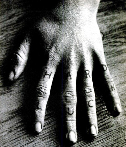 The HARD LUCK tattoos on Billy Cook's left hand. The actual letters were much lighter and were darkened for this photograph.