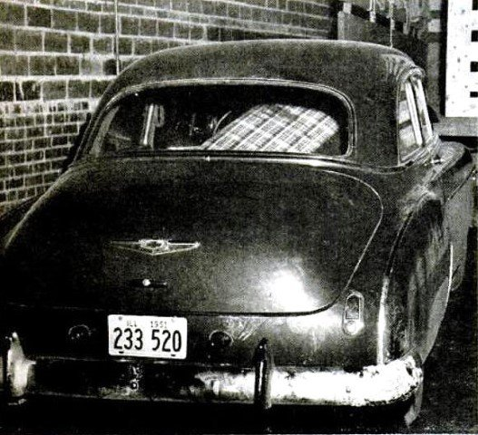 The two-door Chevrolet owned by Carl Mosser after it was towed to a garage.