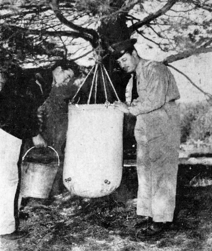 A Lister bag being set up to treat drinking water for the men involved in the rescue.