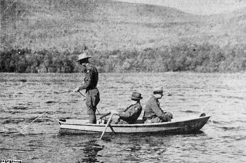New Hampshire conservation officers dragging Iona Lake for the body of Pamela Hollingworth.