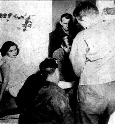 Firemen work to free Virginia Schoen's toe from her refrigerator.