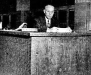 William H. Oglesbee at his penny covered desk in 1949