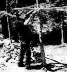 Last Man Bud Boyd building a shelter for his family.