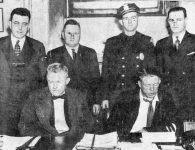 Harry C. Walter is seated on the left, William Chester Marcum to his right.