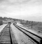 1943 photograph taken in Camden, Missouri. Looking east on the Atchison, Topeka, and Santa Fe Railroad where it crosses over the Wabash Railroad tracks.