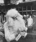 Santa Claus making a toy in 1907.