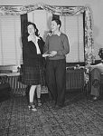 Jerry Senise and Mary Lou Grubles of Blue Island, Illinois as they dance to music on the radio before going out on a date.
