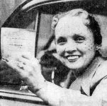 Muriel Nicholson holding her driver's license.