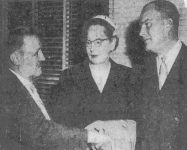 Frank Troiani shaking hands with Roy Carlson and his wife